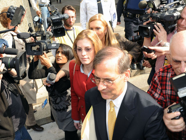 Jaynie Mae Baker and her attorney Robert Gottlieb leave Manhattan Supreme Court amid a throng of press photographers.
