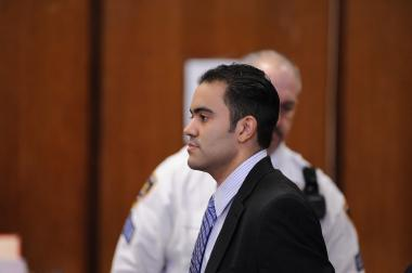 Accused Rape Cop Michael Pena arrives in court Thursday, March 15, 2012.