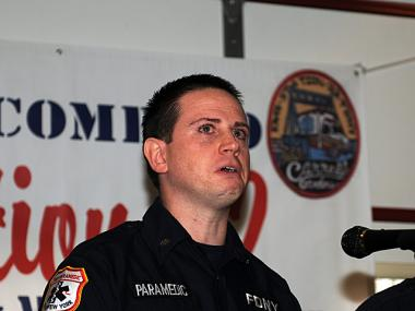 Carl Gandolfo tears up while talking about saving a newborn baby in Brooklyn on March 14, 2012.