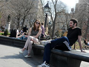 Visitors to Washington Square Park soak up the warm weather on the first day of spring, March 20, 2012.
