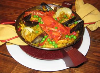 Manolo Tapas' Paella Marinera includes lobster, littleneck clams, mussels, scallops, shrimp, and squid in slow-cooked saffron bomba rice for $27.