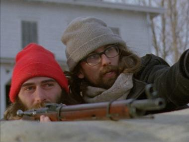 Characters Paul (R) and Thomas(L), played by Paul Manza and director Ben Dickinson, prepare to shoot a deer in the film