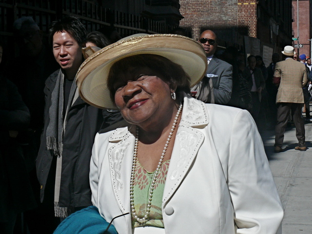 Delores J. wearing simple and chic golden halo style hat.