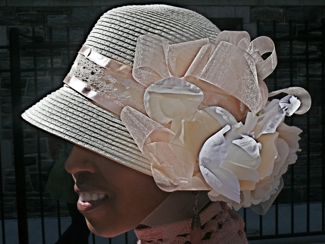 Lashekia C. cloche style confection of ribbon, lace and roses.