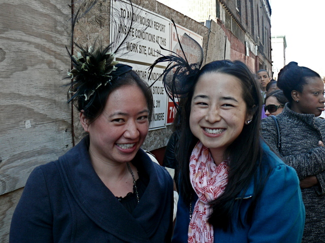 Michelle N. and Julia C. in plume and net fascinators.