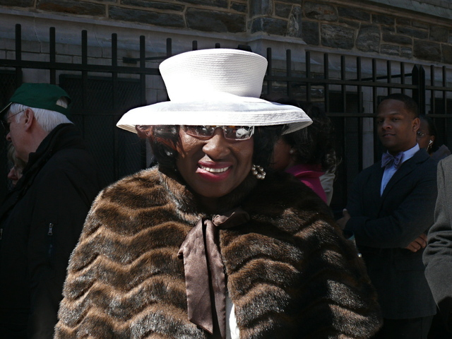 Patricia A. in a simple white hat with a wide crown.