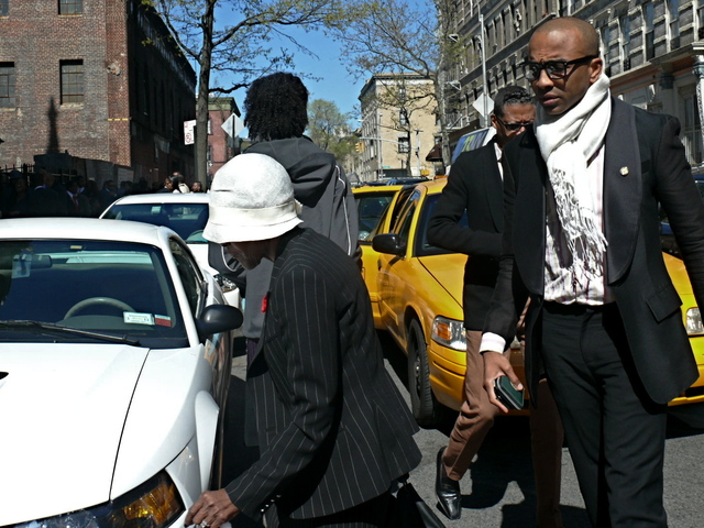 Actress Cicely Tyson arrives in soft straw cloche hat and sharp pinstripe suit.