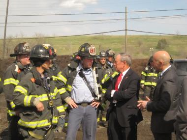 Mayor Michael Bloomberg talks to firefighters at the scene of the massive brush fire at the Fresh Kills Landfill on April 10, 2012.