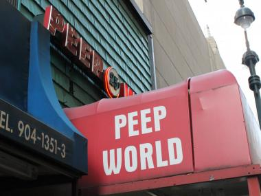 The iconic red sign at Peep World, which closed down at the end of March.