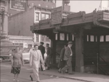 The East 60th Street lamppost can be seen in the background near the kiosk for the Queensboro Bridge trolley station.