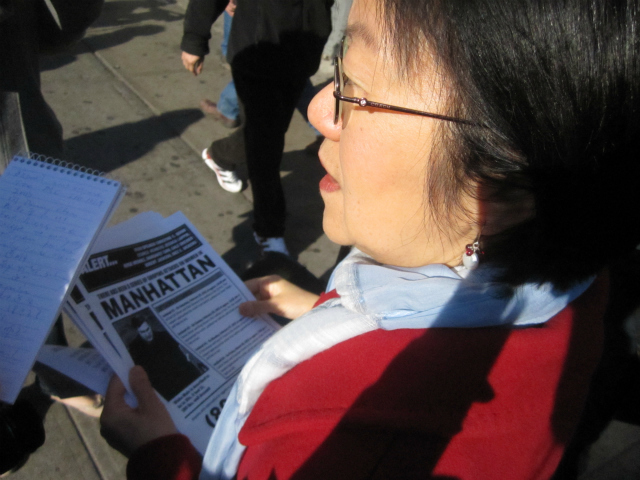 Councilwoman Margaret Chin held a stack of NYPD flyers about a groping spree Downtown and on the Upper East Side.