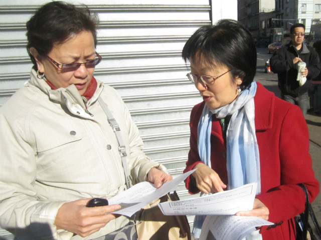 Councilwoman Margaret Chin discusses the recent groping incidents with a woman in Chinatown April 12, 2012.