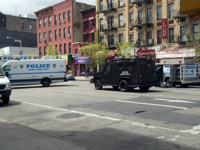 Several police vehicles were on scene at First Avenue and 119th Street on  Thursday, April 12, 2012 in East Harlem.