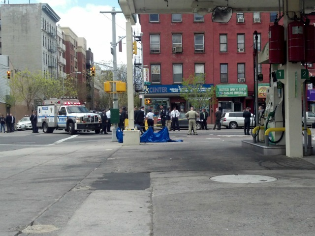 Police shot and killed an armed drugstore robber on Thursday, April 12, 2012 in East Harlem.