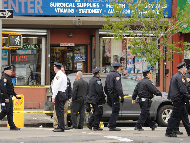 Police — including a retired lieutenant — shot and killed an armed drugstore robber in East Harlem Thursday morning.