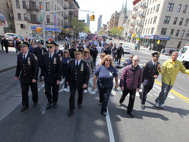 NYPD Chief of Department Joseph J. Espositio, 62, (center) joins Mary Jo Buczek, (right) sister of slain cop Michael Buczek in Washington Heights on Apr. 14th, 2012.