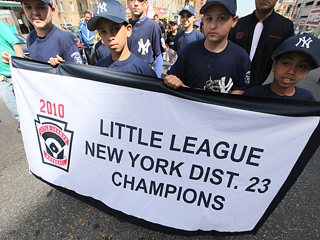 Children march in the annual Michael Buczek Baseball Little League Parade in Washington Heights on Apr. 14th, 2012.
