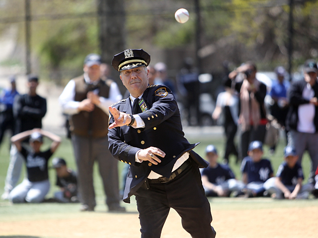 NYPD Chief of Department Joseph J. Espositio, 62, throws out the first pitch at the Michael Buczek ball park in Washington Heights on Apr. 14th, 2012.