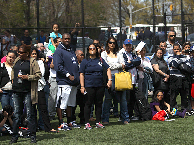 Local residents from Washington Heights attend the annual Michael Buczek Little League Baseball ceremony on Apr. 14th, 2012.