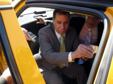 Former Gov. David Paterson, who is visually impaired, tries out the new system.