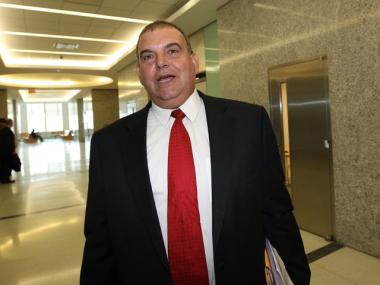 Williamsburg antique store owner Joseph Loiacono at Brooklyn Supreme Court on April 18, 2012, to face charges he threatened a woman with a power saw.