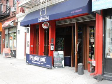 Police said three men attack and seriously injured a bartender at Perdition in Hell's Kitchen.