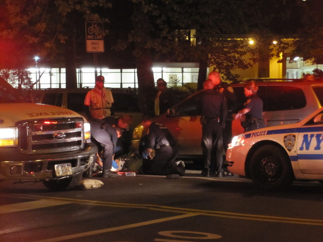 Officials tends to a pedestrian  struck on the Lower East Side after 9 p.m. on April 19, 2012, on East Broadway.