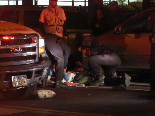 Officials tend to a pedestrian  struck on the Lower East Side after 9 p.m. on April 19, 2012, on East Broadway.