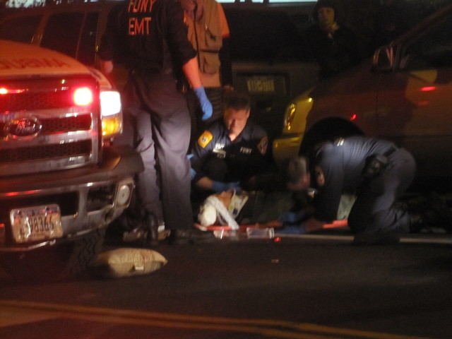 Officials tend to a pedestrian  struck on the Lower East Side after 9 p.m. April 19, 2012, on East Broadway.