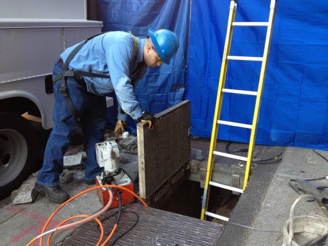 A worker at 127 Prince St., where FBI and NYPD investigators began digging while searching for the remains of Etan Patz.