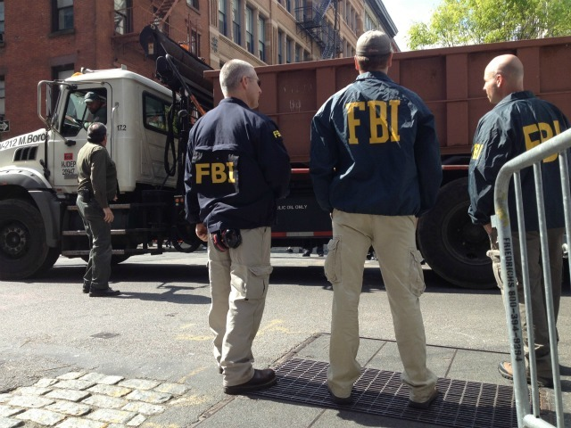 Officials at the scene on Fri., April 20, 2012.