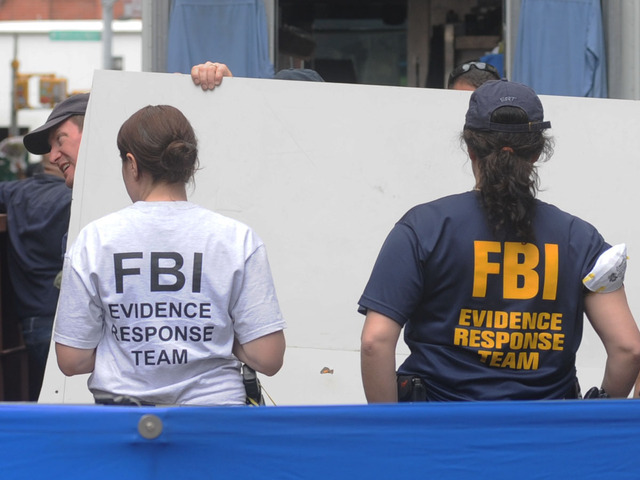 The FBI brought material out of 127 Prince St. April 20, 2012.