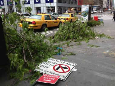 Debris is strewn across the sidewalk on West 42nd Street and Sixth Avenue on April 22, 2012 after an accident there the night before.