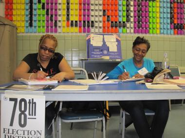 Elections workers Constance Johnson, 29, and Brenda Greene, 52, agreed things were slow at the site on Tues., April 24, 2012.