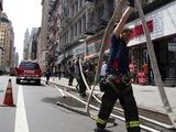 Firefighters Battle Blaze at Shoe Store on Broadway