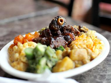 Freda's Caribbean & Soul Cuisine's most popular dish is oxtail served with callaloo, chick peas,curry potatoes,cabbage and rice.