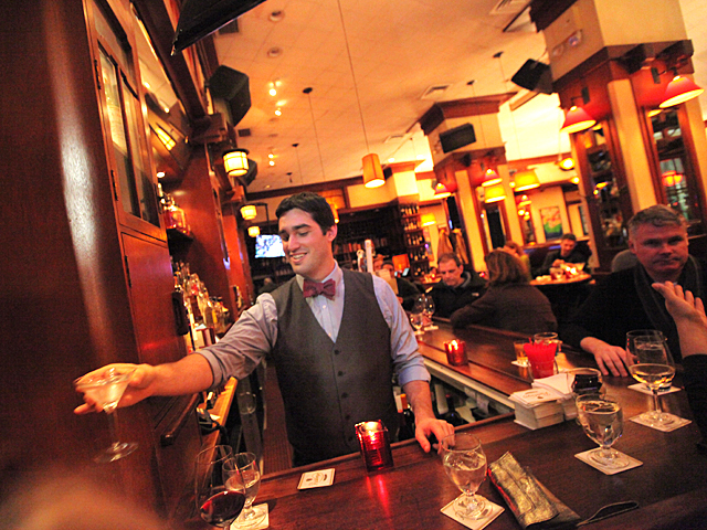 <p>Ryan Favorite, 26, tending the bar at Henry&#39;s Restaurant.</p>