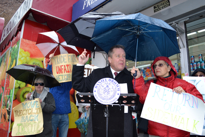 Councilman Daniel Dromm held a rally Jan. 17 outside Trade Fair in the Jackson Heights section of Queens, calling for the supermarket to take down an illegal enclosure. The enclosure can be seen at left.