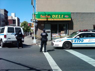 Cops investigate a double shooting on Humboldt and Moore streets in Bushwick on April 29, 2012.