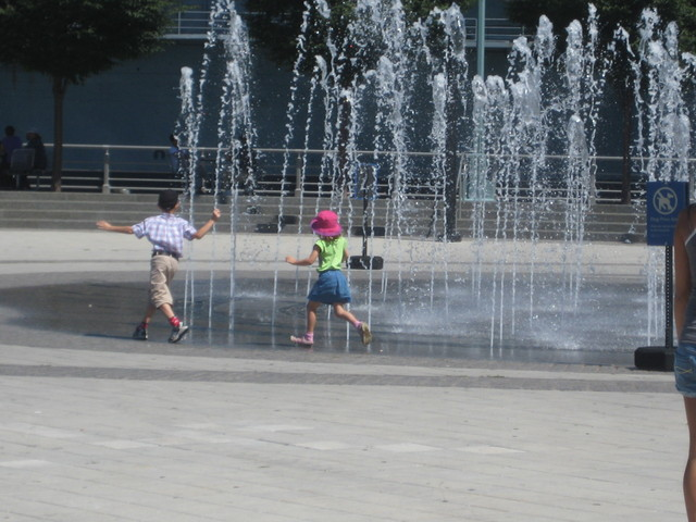 Kids play in the water fountain at Pier 84 in Hudson River Park in August 2010.