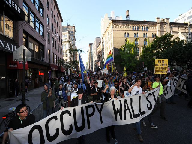 <p>Occupy Wall Street protesters march down Broadway from Union Square in celebration of May Day on May 1, 2012.</p>
