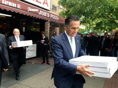 Mitt Romney and Rudy Giuliani carried stacks of Joe's pizzas May 1, 2012.