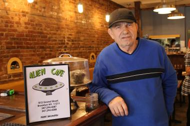 The Alien Cafe owner Spiros Zimas hopes his new business will thrive on Grand Street despite high vacancies on the block.