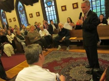Council Member Jimmy Van Bramer addresses the community's concerns at a town hall meeting in Sunnyside