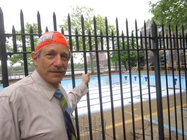 John Steinberg believes the city's public pools would be cleaner if swim caps were mandated.