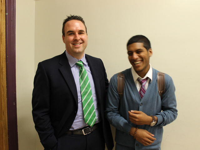 Brooklyn Latin School's headmaster Jason Griffiths and senior Arshad Asarali, 18, exchanged laughed in the hallway.