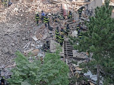 Firefighters searched through the rubble at 110 W. 123rd St. May 4, 2012.