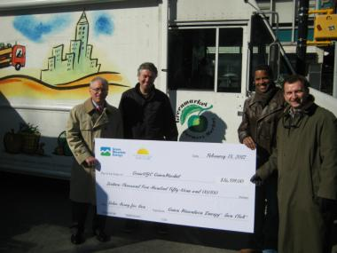 Union Square's Greenmarket receives a donation from Green Mountain to outfit an educational van with solar panels. Pictured left to right: Paul Markovich, Green Mountain; David Hughes, Union Square Greenmarket; R. David Gibbs, Solar One; John Holtz, Green Mountain.