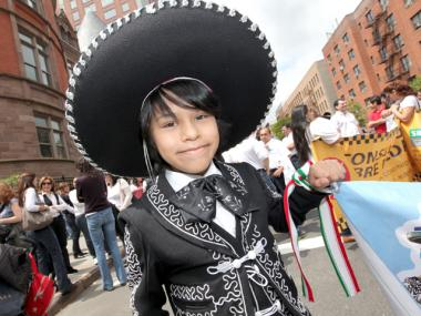 Jesus Anthony Perez, 10, of Astoria, Queens enjoys the annual Cinco de Mayo Parade on Central Park West on May 6, 2012.
