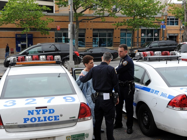 Eduardo Vias, who allegedly stabbed his girlfriend in the neck on May 7, 2012, being led out of a patrol car in Staten Island.